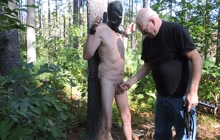 Gay slave whipped in the forest