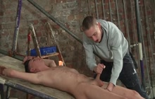 Bound gay gets a handjob