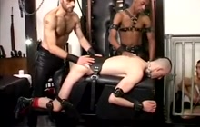 Tied dude gets spanked by masters