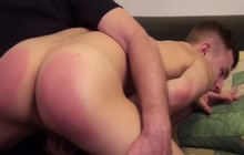 Boy bends over and gets spanked